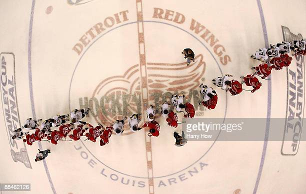 The Pittsburgh Penguins are congratulated by the Detroit Red Wings after a 21 win in Game Seven and the 2009 NHL Stanley Cup Finals at Joe Louis...