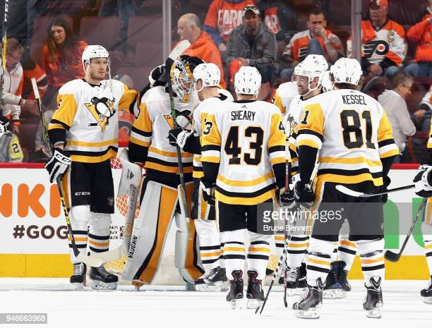 The Pittsburgh Penguins celebrate a 51 victory over the Philadelphia Flyers in Game Three of the Eastern Conference First Round during the 2018 NHL...