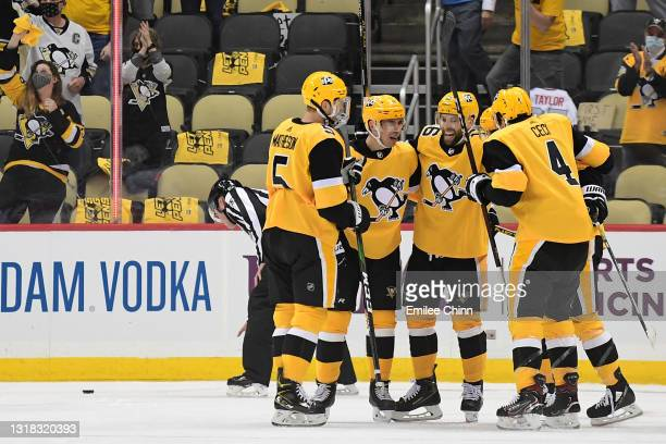 The Pittsburgh Penguins celebrate a goal by Frederick Gaudreau in the first period against the New York Islanders in Game One of the First Round of...
