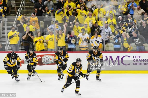 The Pittsburgh Penguins celebrate after a goal by Phil Kessel during the third period in Game Two of the 2017 NHL Stanley Cup Final against the...