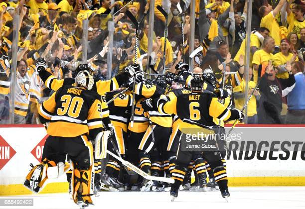 The Pittsburgh Penguins celebrate after Chris Kunitz scored the game winning goal against Craig Anderson of the Ottawa Senators in the second...
