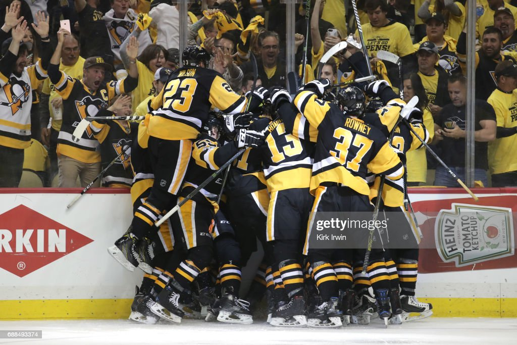The Pittsburgh Penguins celebrate after Chris Kunitz #14 scored the game winning goal against Craig Anderson #41 of the Ottawa Senators in the second overtime with a score of 3 to 2 in Game Seven of the Eastern Conference Final during the 2017 NHL Stanley Cup Playoffs at PPG PAINTS Arena on May 25, 2017 in Pittsburgh, Pennsylvania.