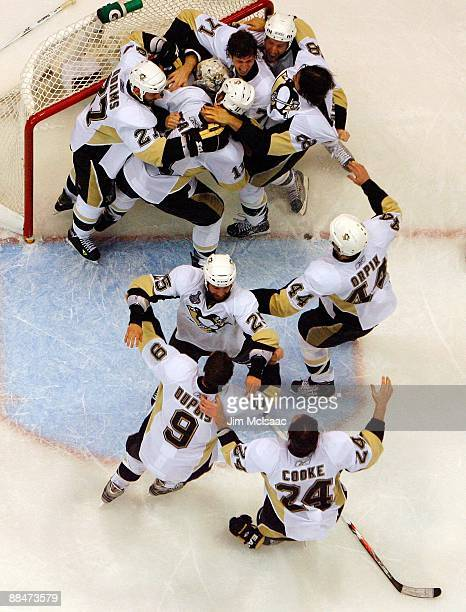 The Pittsburgh Penguins celebrate after defeating the Detroit Red Wings by a score of 21 to win Game Seven and the 2009 NHL Stanley Cup Finals at Joe...