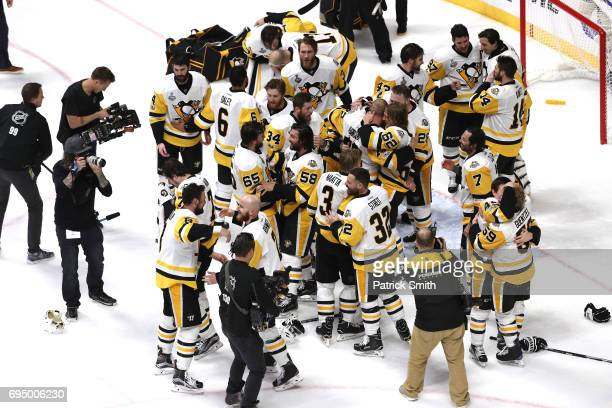 The Pittsburgh Penguins celebrate after defeating the Nashville Predators 2-0 to win the 2017 NHL Stanley Cup Final at the Bridgestone Arena on June...