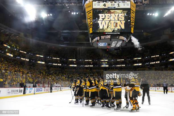 The Pittsburgh Penguins celebrate after defeating the Nashville Predators 41 in Game Two of the 2017 NHL Stanley Cup Final at PPG Paints Arena on May...
