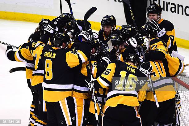 The Pittsburgh Penguins celebrate after defeating the Tampa Bay Lightning in Game Seven of the Eastern Conference Final with a score of 2 to 1 during...