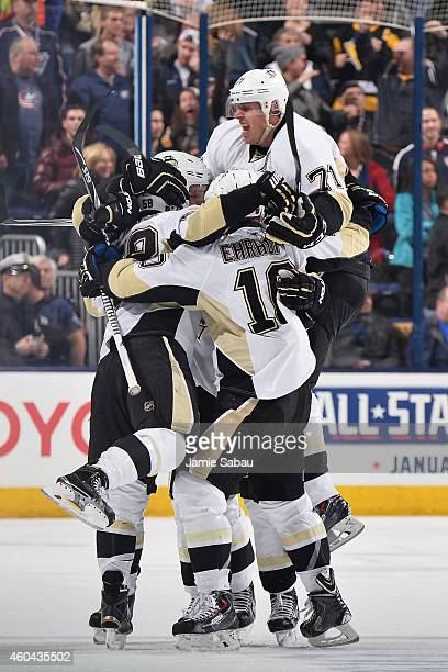 The Pittsburgh Penguins celebrate after scoring a game-tying goal late in the third period of a game against the Columbus Blue Jackets on December...