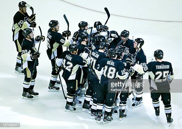 The Pittsburgh Penguins celebrate after winning 32 on a shootout goal by defenseman Matt Niskanen against the Los Angeles Kings during Tuesday's...