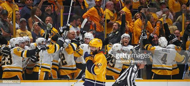 The Pittsburgh Penguins celebrate on the bench during the final moments of a defeat of the Nashville Predators 20 in Game Six of the 2017 NHL Stanley...