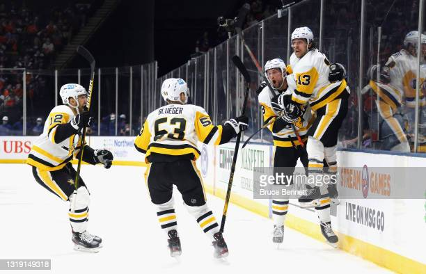 The Pittsburgh Penguins celebrate the game winning goal by Brandon Tanev against the New York Islanders at 16:24 of the third period in Game Three of...