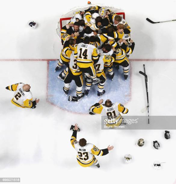 The Pittsburgh Penguins celebrate their 20 victory over the Nashville Predators in Game Six of the 2017 NHL Stanley Cup Final at the Bridgestone...