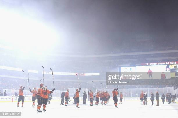 The Pittsburgh Penguins celebrate their 4-3 overtime victory against the Pittsburgh Penguins during the 2019 Coors Light NHL Stadium Series game at...