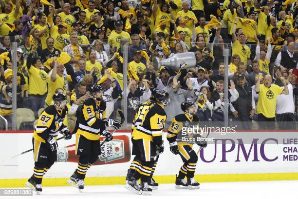 The Pittsburgh Penguins celenbrate a goal by left wing Conor Sheary at 1637 of the during the first period against the Nashville Predators in Game...