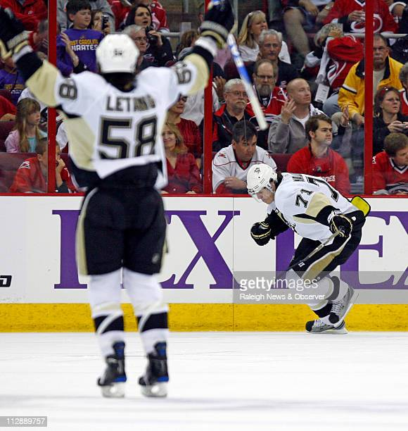 The Pittsburgh Penguins' Evgeni Malkin celebrates his goal wit teammate Kris Letang during first period action against the Carolina Hurricanes in...
