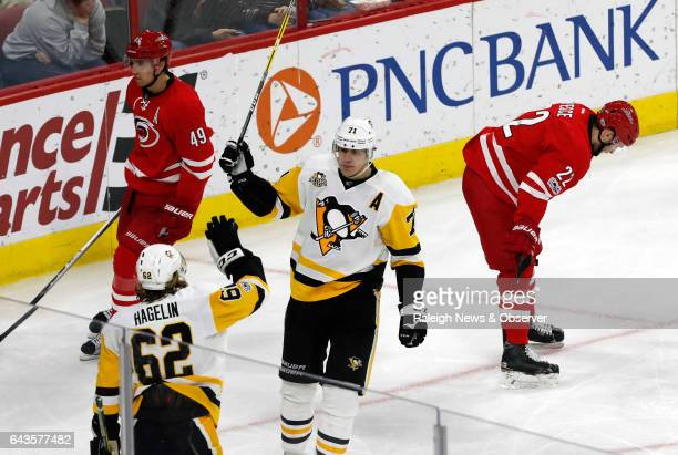 The Pittsburgh Penguins' Evgeni Malkin celebrates his goal with Carl Hagelin during the third period against the Carolina Hurricanes at PNC Arena in...