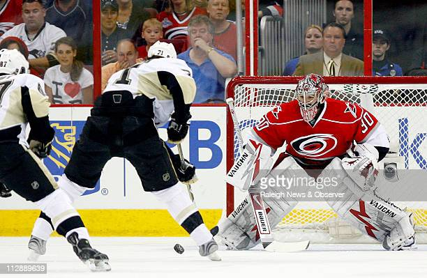 The Pittsburgh Penguins' Evgeni Malkin's gets ready to score his first goal against Carolina Hurricanes goalie Cam Ward during first period action in...