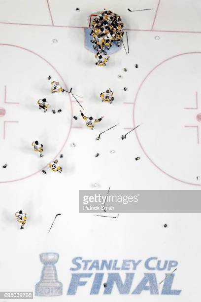 The Pittsburgh Penguins mob goalie Matt Murray as they celebrate their 20 win over the Nashville Predators to win the 2017 Stanley Cup in Game Six of...