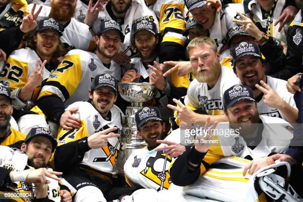 The Pittsburgh Penguins pose for a group photo with the Stanley Cup Trophy after they defeated the Nashville Predators 20 in Game Six of the 2017 NHL...