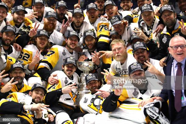 The Pittsburgh Penguins pose for a group photo with the Stanley Cup Trophy after they defeated the Nashville Predators 2-0 in Game Six of the 2017...