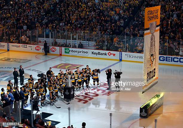 The Pittsburgh Penguins watch their 2016 Stanley Cup Championship banner being raised to the rafters before the game against Washington Capitals at...