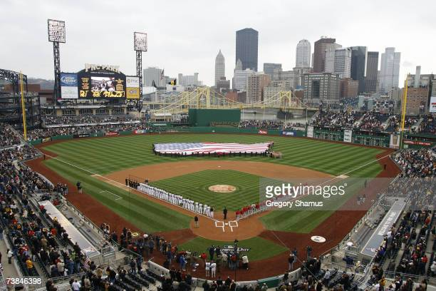The Pittsburgh Pirates and St Louis Cardinals line up for the National Anthem prior to the Pirates' Home Opener April 9 2007 at PNC Park in...