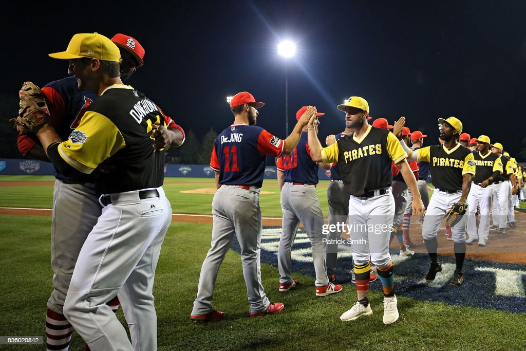 The Pittsburgh Pirates and the St. Louis Cardinals shake hands following the inaugural MLB Little League Classic at BB&T Ballpark at Historic Bowman Field on August 20, 2017 in Williamsport, Pennsylvania.
