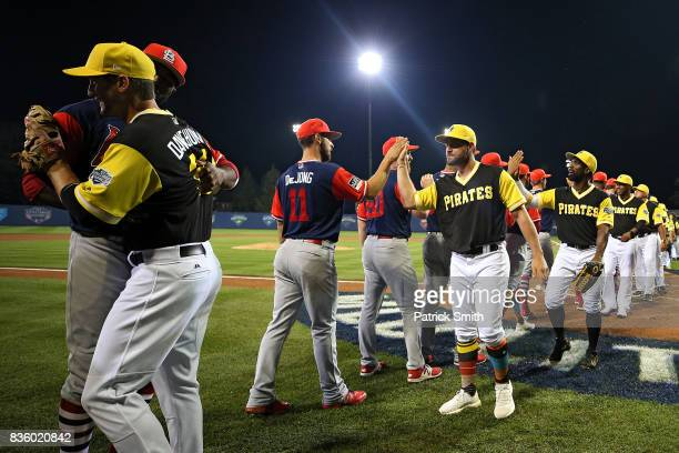 The Pittsburgh Pirates and the St Louis Cardinals shake hands following the inaugural MLB Little League Classic at BBT Ballpark at Historic Bowman...
