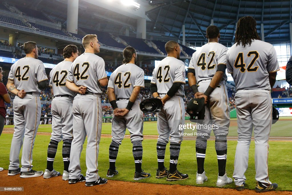 The Pittsburgh Pirates look on during the playing of God Bless America in the seventh inning against the Miami Marlins at Marlins Park on April 15, 2018 in Miami, Florida. All players are wearing #42 in honor of Jackie Robinson Day.