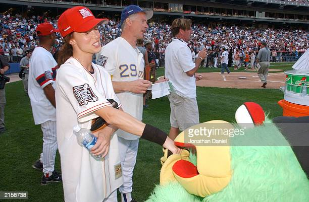 The Pittsburgh Pirates' mascot kisses the hand of Shannon Elizabeth before the All Star Legends and Celebrity Softball Game on July 13 2003 at US...