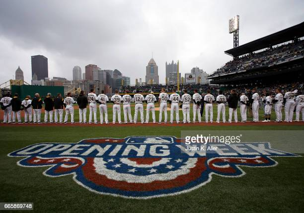 The Pittsburgh Pirates stand during the National Anthem before the game against the Atlanta Braves on Opening Day at PNC Park on April 7 2017 in...