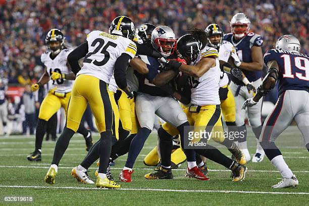 The Pittsburgh Steelers attempt to tackle LeGarrette Blount of the New England Patriots in the AFC Championship Game at Gillette Stadium on January...