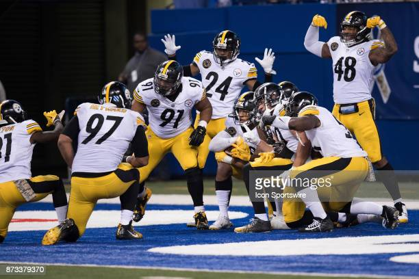 The Pittsburgh Steelers defense gathers in the end zone to celebrate a interception during the NFL game between the Pittsburgh Steelers and...