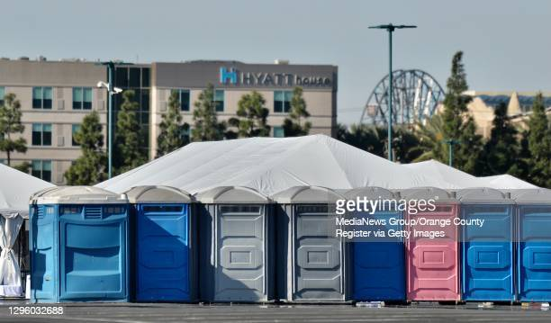 The Pixar Pal-A-Round ride at Disney California Adventure Park sits behind bathrooms and COVID-19 vaccination tents that are set up in the north of...