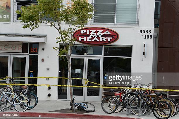The Pizza My Heart restaurant is corndoned off by police tape on May 24 after a driveby shooting in Isla Vista California a beach community next to...