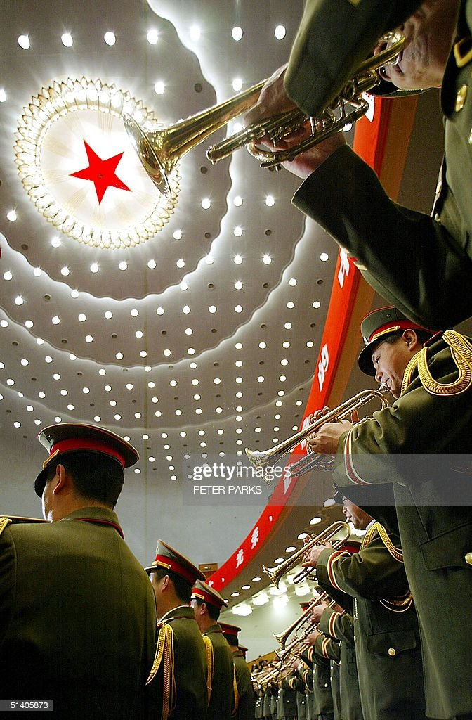 The PLA band play at the end of the 16th Comunist Party Congress in the Great Hall of The People in Beijing, 14 November 2002. The congress ended with a sweeping generational change of its leadership as President Jiang Zemin and five other elderly leaders standing down from their posts in the ruling Communist party with Premier Zhu Rongji and party number two Li Peng among the leaders not elected to the party's new Central Committee. AFP PHOTO/Peter PARKS