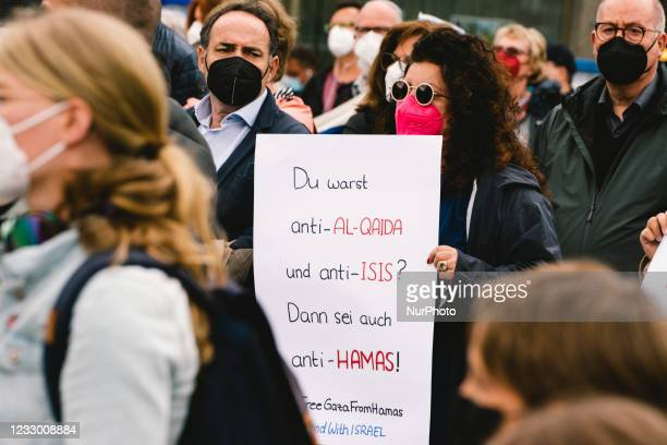"""The placard """" you are against Al Quida and against ISIS, then you should against Hamas"""" is seen during the pro Israel anti Semitism rally..."""