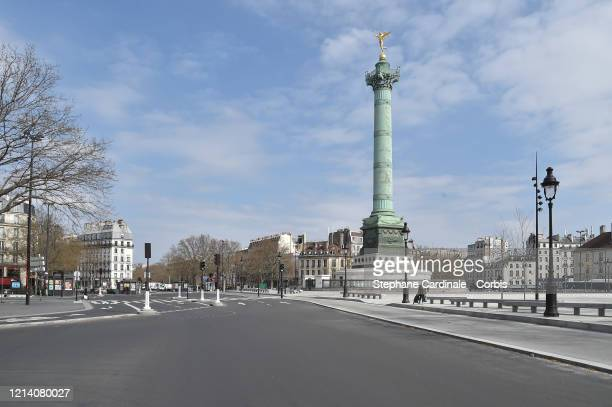 The Place de la Bastille is empty on March 22 2020 in Paris France Coronavirus has spread to at least 182 countries claiming over 13600 lives and...