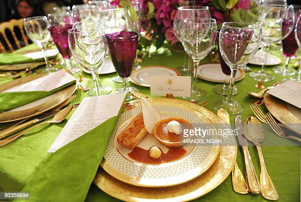 The place setting for the President is seen during a preview for the first State Dinner hosted by the US President Barack Obama for Indian Prime...