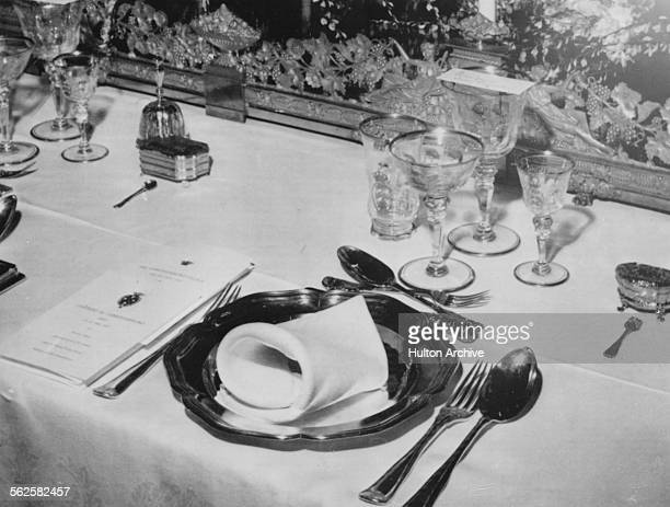 The place setting of Queen Elizabeth II with solid gold tableware laid out during the State Banquet at the Christiansborg Palace Copenhagen May 21st...