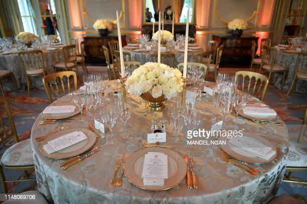 The place setting of US President Donald Trump is pictured on the top table ahead of a dinner with Britain's Prince Charles Prince of Wales at...