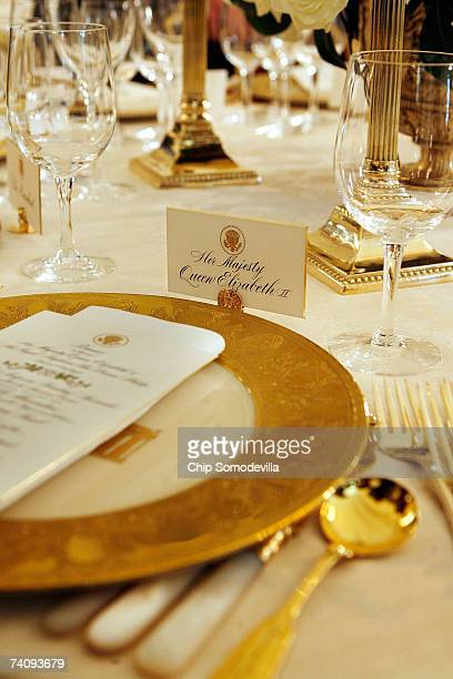 The place settings for Queen Elizabeth II sit ready in advance of the state dinner in her honor in the State Dining room on the State Floor of the...