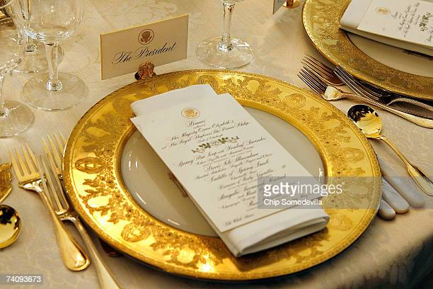 The place settings for U.S. President George W. Bush sit ready in advance of the state dinner honoring Queen Elizabeth II in the State Dining room on...