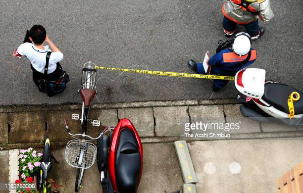 The place where an arson suspect fell has been marked and secured after a fire at a studio of Kyoto Animation Co. On July 18, 2019 in Kyoto, Japan....