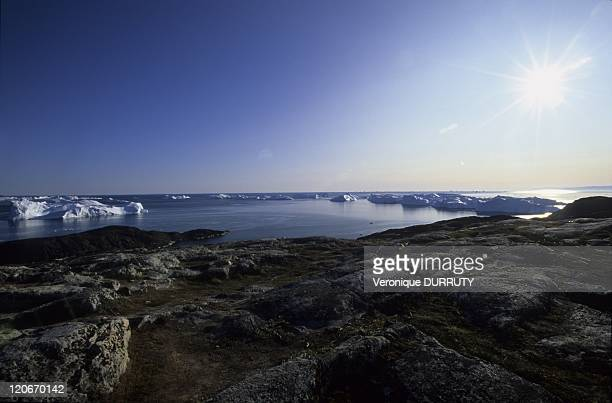The place where Kangia meet the sea in Ilulissat Greenland The Ilulissat Ice fjord runs west 40 km from the Greenland ice sheet to Disko Bay close to...