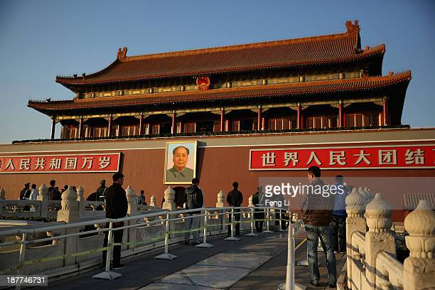 The plainclothes policemen guard in front of Tiananmen Gate outside the Great Hall of the People where the Communist Party's 205member Central...
