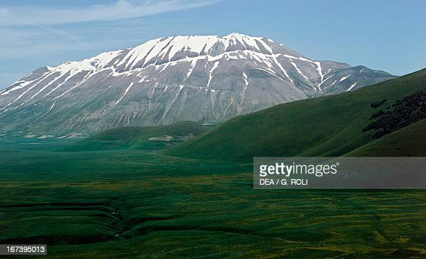 The Plains of Castelluccio and Monte Vettore in the background Sibillini Mountains National Park Umbria Italy