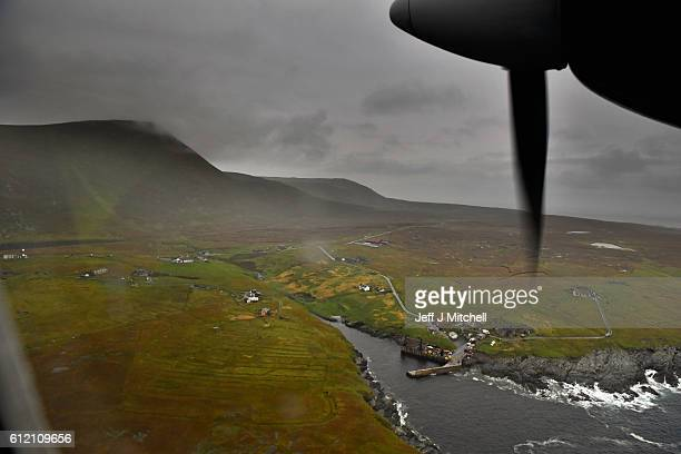 The plane arrives from Tingwall airport at the Island of Foula airstrip on September 28 2016 in Foula Scotland Foula is the remotest inhabited island...
