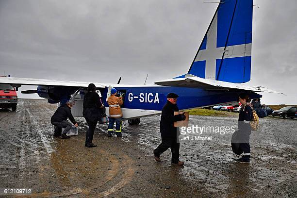 The plane arrives from Tingwall airport at the Island of Foula airstrip on September 28, 2016 in Foula, Scotland. Foula is the remotest inhabited...