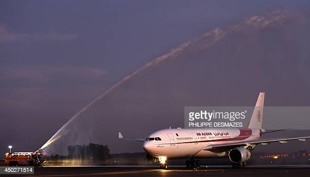The plane carrying Algeria's national football team lands at Campinas airport on June 8 2014 ahead of the 2014 FIFA World Cup football tournament in...
