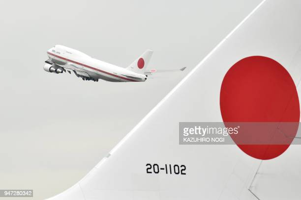 The plane carrying Japan's Prime Minister Shinzo Abe takes off for the US from Tokyo's Haneda airport on April 17 2018 US President Donald Trump...